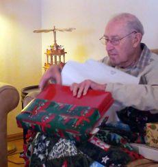 Grandpa Bill opening Christmas present